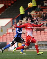 Swindon's Nathan Byrne and Orient's Chris Dagnall compete for the ball - Photo mandatory by-line: Mitchell Gunn/JMP - Tel: Mobile: 07966 386802 22/02/2014 - SPORT - FOOTBALL - Brisbane Road - Leyton - Leyton Orient V Swindon Town - League One