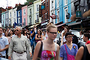 Famous like of coloured houses which giuide you to Portobello Road market, Notting Hill, West London. This famous Saturday market is when the antique stalls line the streets as well as the food stalls further down the hill. This is classic London with busy crowds of people coming to hang out, maybe buy something, or just browse the stalls and have some food.