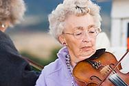 Senior woman fiddler, Alberta Wood, Montana Old Time Fiddlers Picnic, Livingston Montana<br /> MODEL RELEASED