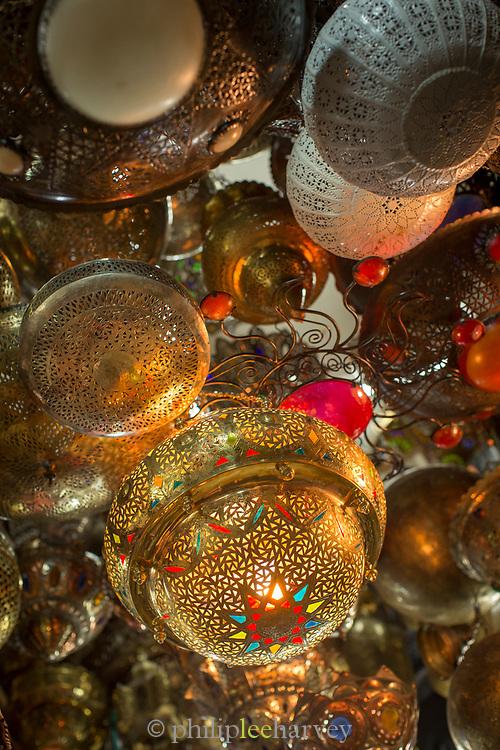 Close up of merchandise with brass lanterns in antique market, Casablanca, Morocco