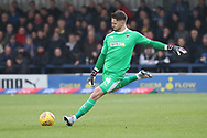 AFC Wimbledon goalkeeper Joe McDonnell (24) clearing ball during the EFL Sky Bet League 1 match between AFC Wimbledon and Southend United at the Cherry Red Records Stadium, Kingston, England on 24 November 2018.