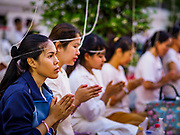 31 DECEMBER 2018 - BANGKOK, THAILAND: Women pray during New Year's Eve prayers and meditation at Wat Pathum Wanaram in central Bangkok. Many Thais go to temples to meditate and pray on New Year's Eve.    PHOTO BY JACK KURTZ