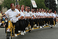 Eastren Illinois shriners ride 25-man bicycle in annual Circus City Parade in Peru, Indiana.
