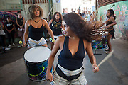Female drumming batallion performing in Vidigal. Since pacification in 2011, Vidigal has slowly become known as what some call a model favela, seen as the safest favela in Rio, home to a mixed community which now includes foreigners, hostels, restaurants, theatres and creative businesses.