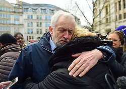 Labour Party leader Jeremy Corbyn hugs a woman after the Grenfell Tower National Memorial Service at St Paul's Cathedral in London, to mark the six month anniversary of the Grenfell Tower fire.