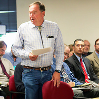 Les Gaines, Grants assistant city manager, speaks Monday in support of allowing the Mount Taylor Mine to return to active status, during a hearing in Santa Fe.