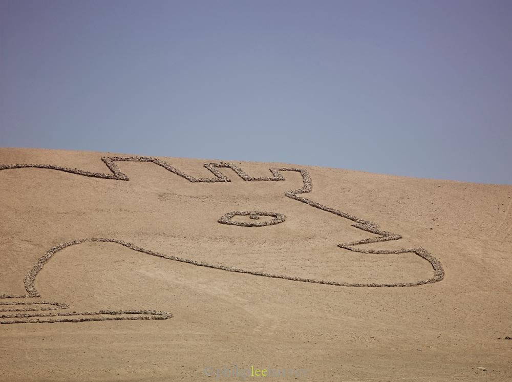 Stone sculpture on a hillside in the Atacama Desert, Chile