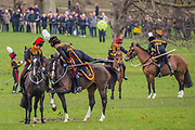 The female officers mount up as Troop leaves Green Park. On the 100th anniversary of women getting the vote, Kings troop is led by female officers and has a high proportion of female troopers - The King's Troop Royal Horse Artillery, ride their horses and gun carriages past Buckingham Palace to Green Park to stage a 41 Gun Royal Salute to mark the 66th Anniversary of the Accession of Her Majesty The Queen.
