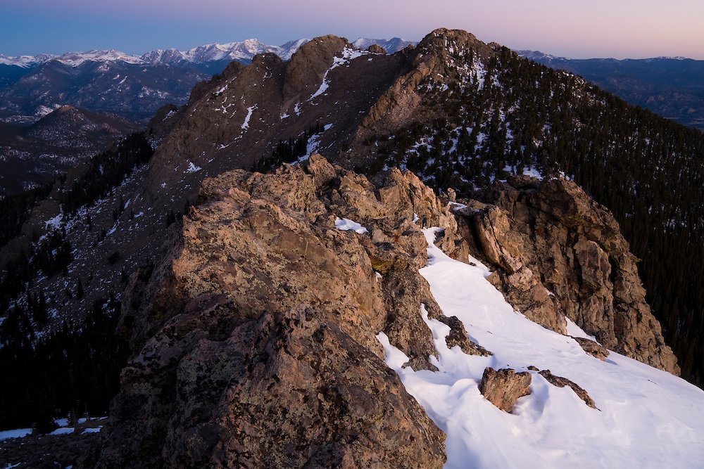 The rocky summit of Twin Sisters Mountain at dawn in Rocky Mountain National Park, Colorado.