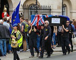 October 14, 2017 - London, London, United Kingdom - Protesters from No 10 Vigil For Victory organisation marched in Whitehall to demonstrate Britain leaving the European Union. A funeral procession passed Downing Street in Westminster and the protesters rally in Parliament Square. (Credit Image: © Dinendra Haria/i-Images via ZUMA Press)