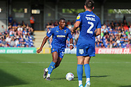 AFC Wimbledon defender Paul Kalambayi (30) dribbling and about to pass the ball during the EFL Sky Bet League 1 match between AFC Wimbledon and Shrewsbury Town at the Cherry Red Records Stadium, Kingston, England on 14 September 2019.