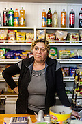 Grocery store owner Vali Coanca - who has Roma ethnicity -  is running since 20 years together with her family their own shop located at the main road in Marginenii de Jos.