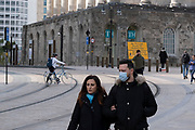 With new local coronavirus lockdown measures now in place and Birmingham currently set at 'Tier 2' or 'high', people wearing face masks pass Birmingham Town Hall in the city centre on 14th October 2020 in Birmingham, United Kingdom. This is the first day of the new three tier system in the UK which has levels: 'medium', which includes the rule of six, 'high', which will cover most areas under current restrictions; and 'very high' for those areas with particularly high case numbers. Meanwhile there have been calls by politicians for a 'circuit breaker' complete lockdown to be announced to help the growing spread of the Covid-19 virus.