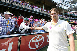 © Licensed to London News Pictures. 05/01/2014. Shane Watson shakes hands with a spectator after during celebration lap during day 3 of the 5th Ashes Test Match between Australia Vs England at the SCG on 5 January, 2013 in Melbourne, Australia. Photo credit : Asanka Brendon Ratnayake/LNP