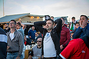 England fans watching the the Euro 2020 semi final match between England and Denmark on the 7th of July 2021 at the outdoor screen at Folkestone Harbour Arm, in Folkestone, United Kingdom.