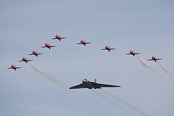 © Licensed to London News Pictures. 18/07/2015. RAF Fairford, UK. Vulcan flying in Formation with the Red Arrows. The Royal International Air Tattoo (RIAT). Photo credit : Ian Schofield/LNP