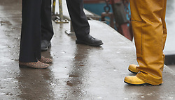 Contrasting footwear as Prime Minister Theresa May (left) goes on a General Election visit to Plymouth Fisheries, while campaigning in Devon.