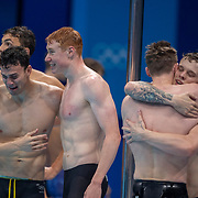 TOKYO, JAPAN - JULY 28: The gold medal winning team of James Guy, Tom Dean, Matthew Richards and Duncan Scott of Great Britain celebrate after victory in the 4x200M relay for Men during the Swimming Finals at the Tokyo Aquatic Centre at the Tokyo 2020 Summer Olympic Games on July 28, 2021 in Tokyo, Japan. (Photo by Tim Clayton/Corbis via Getty Images)