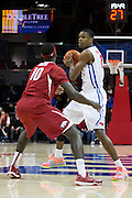 DALLAS, TX - NOVEMBER 25: Yanick Moreira #2 of the SMU Mustangs brings the ball up court against the Arkansas Razorbacks on November 25, 2014 at Moody Coliseum in Dallas, Texas.  (Photo by Cooper Neill/Getty Images) *** Local Caption *** Yanick Moreira