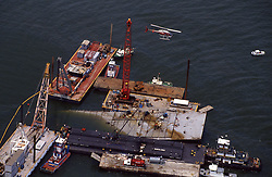 Stock photo of the Apex tank barges leaking oil in the Galveson Bay ship channel on July 28, 1990, Galveston Bay, Texas after The Greek Tank Vessel, Shinoussa, collided with Apex tank barges carrying oil in the Houston Ship Channel. At least 700,000 gallons of partially refined crude oil were discharged from two of the damaged barges. The spread of sheen and mousse in Galveston Bay was extensive.