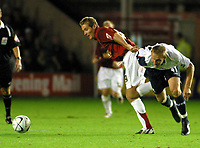 Photo: Dave Linney.<br />Walsall v Bolton Wanderers. Carling Cup. 19/09/2006.<br />Walsall's Martin Butler(R) burts past  Jaroslaw Fojut