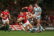James Hook of Wales looks to break through the Argentinan defence. Invesco perpetual series, Wales v Argentina at the Millennium Stadium in Cardiff on Sat 21st Nov 2009. pic by Andrew Orchard, Andrew Orchard sports photography,