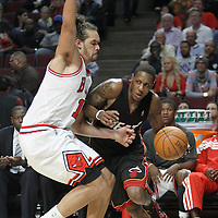14 March 2012: Miami Heat point guard Mario Chalmers (15) drives past Chicago Bulls center Joakim Noah (13) during the Chicago Bulls 106-102 victory over the Miami Heat at the United Center, Chicago, Illinois, USA.