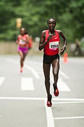 NYRR Mini 10K road race (40th year); Edna Kiplagat, Kenya, on way to winning race