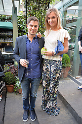 JASON DE SAVARY and STEPHANIE LEDLEY at a party to celebrate 'A Year In The Garden' celebrating the first year of The Ivy Chelsea Garden, 197 King's Road, London on 16th May 2016.