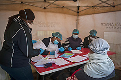 JOHANNESBURG, April 8, 2020  Medics check the forms filled in by citizens before the COVID-19 testing in Johannesburg, South Africa, April 8, 2020. The number of COVID-19 cases in South Africa has risen steadily over the past fews days amid massive community testing in a 21-day national lockdown. .   The country reported a total of 1,749 cases as of Tuesday, an increase of over 60 from Monday's announcement, Health Minister Zweli Mkhize said. (Photo by ShiraazXinhua) (Credit Image: © Xinhua via ZUMA Wire)