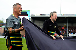 Northampton Saints fans help carry flags onto the pitch after cycling to the game whilst fundraising for charity - Mandatory by-line: Ryan Hiscott/JMP - 18/05/2019 - RUGBY - Sandy Park - Exeter, England - Exeter Chiefs v Northampton Saints - Gallagher Premiership Rugby