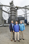 SHOT 10/29/18 9:46:37 AM - Sunrise Cooperative is a leading agricultural and energy cooperative based in Fremont, Ohio with members spanning from the Ohio River to Lake Erie. Sunrise is 100-percent farmer-owned and was formed through the merger of Trupointe Cooperative and Sunrise Cooperative on September 1, 2016. Photographed at the Clyde, Ohio grain elevator was George D. Secor President / CEO and John Lowry<br /> Chairman of the Board of Directors with  CoBank RM Gary Weidenborner. (Photo by Marc Piscotty © 2018)