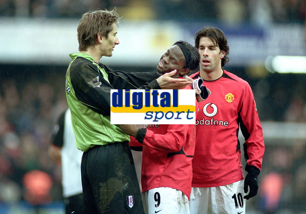 Louis Saha (Utd) talks over the penalty incident with Edwin Van der Sar. Ruud Van Nistelrooy (right). Fulham v Manchester United. 28/2/04. Credit  Digitalsport/Andrew Cowie.