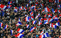 France fans wave flags in the stands