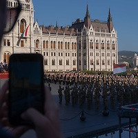 Man records a TikTok video with his mobile phone as army officers graduating from the National University of Public Service take their oath of office during a ceremony in front of the Parliament on Hungarian national holiday in Budapest, Hungary  on Aug. 20, 2020. ATTILA VOLGYI