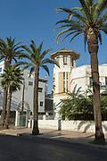 Palm trees growing in front of art deco villa in Casablanca, Morocco