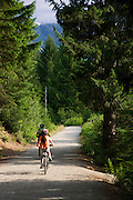 Bike riding on the trail to Lost Lake, Whistler, British Columbia, Canada.