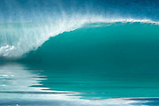 The first wave of a new swell on a perfect morning in Hawaii. Photographic artwork.