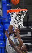 St Louis Billikens forward Hasahn French (11) puts up the ball as Arkansas-Pine Bluff Golden Lions forward Markedric Bell (3) tries to block. St. Louis University hosted the University of Arkansas - Pine Bluff in a mens basketball game on December 5, 2020 at Chaifetz Arena on the SLU campus in St. Louis, MO.<br />Photo by Tim Vizer