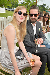 GILLIAN ORR and JACK GUINNESS at the St.Regis International Polo Cup at Cowdray Park, Midhurst, West Sussex on 17th May 2014.