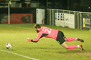 Exeers goalkeeper Jonny Maxted drops on a loose ball during the EFL Sky Bet League 2 match between Harrogate Town and Exeter City at the EnviroVent Stadium, Harrogate, United Kingdom on 19 January 2021.