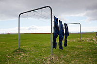 Blue Overalls hanging out to dry outside a farm in South Iceland.