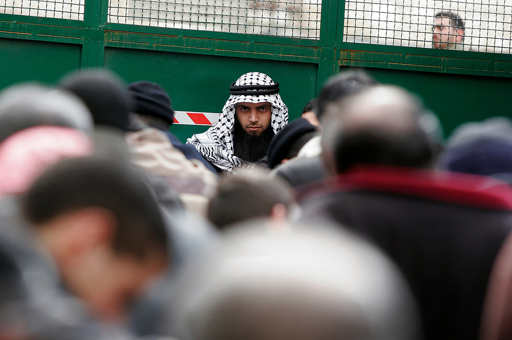 Palestinian men pray on the the way leading to the Al-Aqsa mosque compound in East Jerusalem, February 16, 2007. Only Muslim men aged over 50 and in possession of Israeli identity cards were granted entrance to the main weekly Friday prayers.