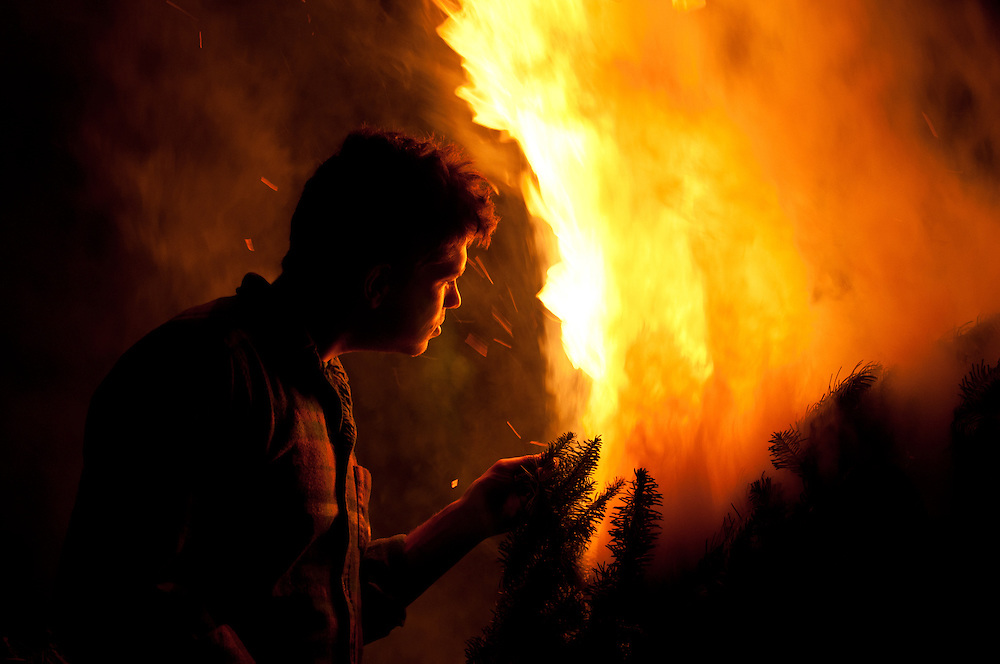 My friend Dan enjoying a Christmas tree burn in Golden Gardens Park, Seattle, Washington.