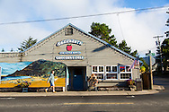 """Manzanita, Oregon, located on Neahkahnie Beach, is a small beach town located in Tillamook County on the Northern Oregon coast.  Manzanita means """"little apple"""" in Spanish. Pictured here is the local grocery store which has a mural of Neahkahnie Mountain and the ocean painted on the front of the building."""