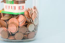 Dec. 14, 2012 - Saving for a house (Credit Image: © Image Source/ZUMAPRESS.com)