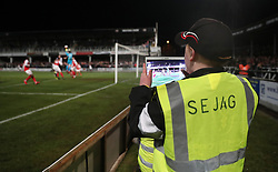 A Ball boy takes a photo on his tablet during the Emirates FA Cup, Second Round Replay at Edgar Street, Hereford.