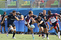 August 09, 2016; Rio de Janeiro, Brazil; USA Men's Eagles Sevens Ben Pinkelman offloads from a tackle against Argentina during the Men's Rugby Sevens Pool A match on Day 4 of the Rio 2016 Olympic Games at Deodoro Stadium. Photo credit: Abel Barrientes - KLC fotos