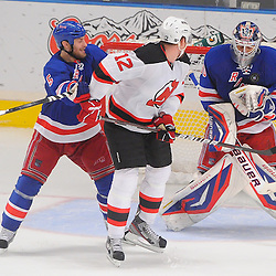 May 16, 2012: New York Rangers goalie Henrik Lundqvist (30) catches a rebound away from New Jersey Devils left wing Alexei Ponikarovsky (12) and New York Rangers defenseman Dan Girardi (5) during third period action in game 2 of the NHL Eastern Conference Finals between the New Jersey Devils and New York Rangers at Madison Square Garden in New York, N.Y. The Devils defeated the Rangers 3-2.