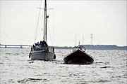 Nederland, Urk, 20-5-2014 Redding en hulpverlening op het ijsselmeer. Een zeiljacht met pech, motorpech, wordt door een reddingsvaartuig, redingsdienst, op sleeptouw genomen.Foto: Flip Franssen/Hollandse Hoogte